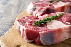 Raw meat on wooden background. Raw meat on wooden table background Royalty Free Stock Photo
