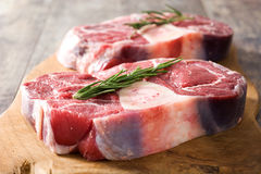 Raw meat on wooden background. Raw meat on wooden table background Stock Photography