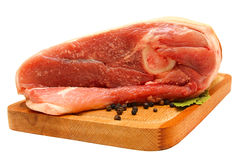 Raw meat on wooden board Stock Images