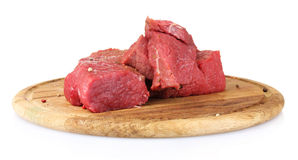 Raw meat on wooden board. Over the white Royalty Free Stock Images