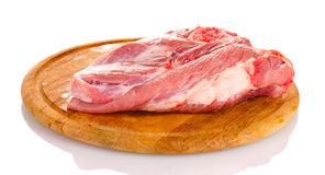 Raw meat on a wooden board Royalty Free Stock Images