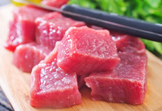 Raw meat. On wooden board Royalty Free Stock Photography