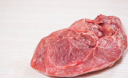 Raw meat at the wooden board with copy space Royalty Free Stock Photos