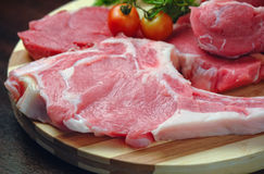 Raw meat on wooden board kitchen Royalty Free Stock Photos