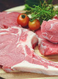 Raw meat on wooden board kitchen Royalty Free Stock Photography