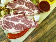 Raw meat on a wooden board pepper, butter, sauce. Raw meat on a wooden board pepper butter sauce Stock Images