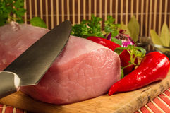 Raw meat on wooden board. Peppers,Onion and herbs Stock Image