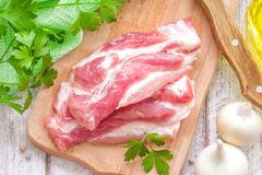 Raw meat. On a wooden chopping board Stock Photos