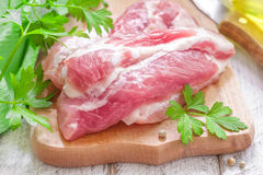 Raw meat. On a wooden chopping board Stock Photo