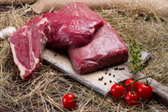 Raw meat on wooden cutting board. Stock Image