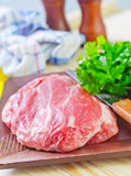Raw meat. On wooden plate Royalty Free Stock Images