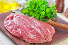 Raw meat. On wooden plate Stock Photo