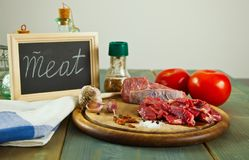 Raw meat on the wooden table Royalty Free Stock Images