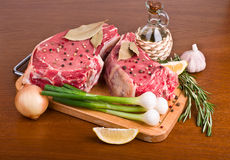 Raw meat on wooden table Stock Photos