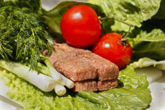 Raw Meatball and Greens Stock Photo