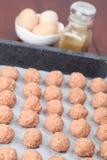 Raw meatballs on baking sheet Stock Photo
