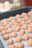 Raw meatballs on baking sheet Stock Photo