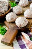 Raw meatballs on the chopping. Board Stock Photography