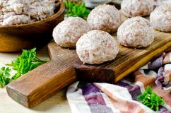 Raw meatballs on the chopping. Board Royalty Free Stock Photo