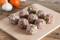 Raw meatballs on a cutting board. Raw meatballs on a cutting board Stock Photo