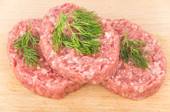 Raw meatballs of ground beef with dill Royalty Free Stock Photos