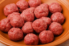 Raw meatballs in plate Stock Image