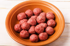 Raw meatballs in plate Stock Photo