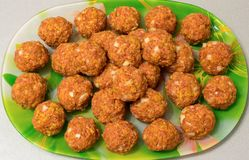 Raw meatballs on a platter. Close up Royalty Free Stock Photography