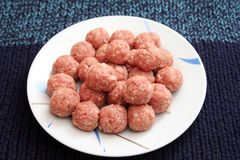 Raw meatballs. Some raw meatballs of pork minced meat royalty free stock image