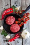 Raw meatballs with vegetables on pan. Raw meatballs on pan with vegetables and spices Stock Image