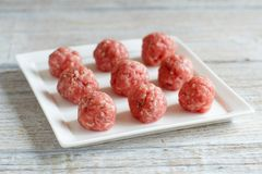 Raw  meatballs are ready to cook. Raw meatballson a plate are ready to cook Stock Photo