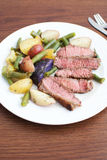 Raw medium steak with potato salad Royalty Free Stock Photography