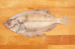 Raw megrim sole. Fish on a wooden chopping board Royalty Free Stock Images