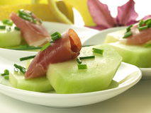 Raw melon with ham Stock Photo