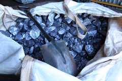 Raw metal materials. Raw aluminium in a bag with a spade lying on it. Used in recycle process of aluminium Royalty Free Stock Photos