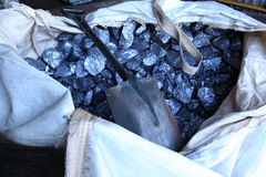 Raw metal materials. Raw aluminium in a bag with a spade lying on it. Used in recycle process of aluminium Stock Photos