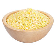Raw millet in bowl isolated Royalty Free Stock Photos