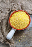 Raw millet in a ceramic bowl. Royalty Free Stock Photo