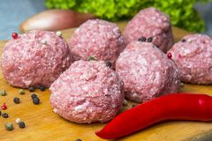 Raw mince patties in a cooking . cutlets are prepared for cutting board royalty free stock image