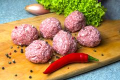 Raw mince patties in a cooking . cutlets are prepared for cutting board stock image