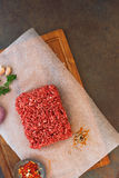 Raw minced beef on butcher paper Stock Photo