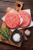 Raw minced beef meat for home made burgers. Raw minced beef meat for home made grill burgers cooking with spaces and herbs. Top view Stock Photo