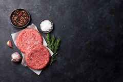 Raw minced beef meat for home made burgers. Raw minced meat and ingredients for home made grill burgers cooking with spaces and herbs. Top view with space for Stock Image