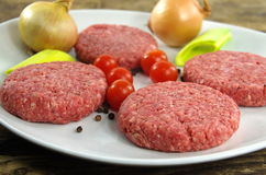 Raw minced beef meat. With onion and tomatoes Stock Images