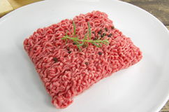Raw minced beef meat. With onion and tomatoes Royalty Free Stock Photo