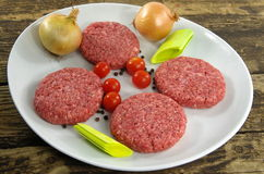 Raw minced beef meat. With onion and tomatoes Stock Photography