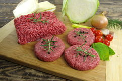 Raw minced beef meat. With onion and tomatoes Royalty Free Stock Photos