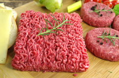 Raw minced beef meat. With onion and tomatoes Stock Image