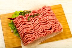 Raw minced beef meat. With thyme and hot pepper Royalty Free Stock Photo