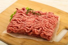 Raw minced beef meat. With thyme and hot pepper Stock Image